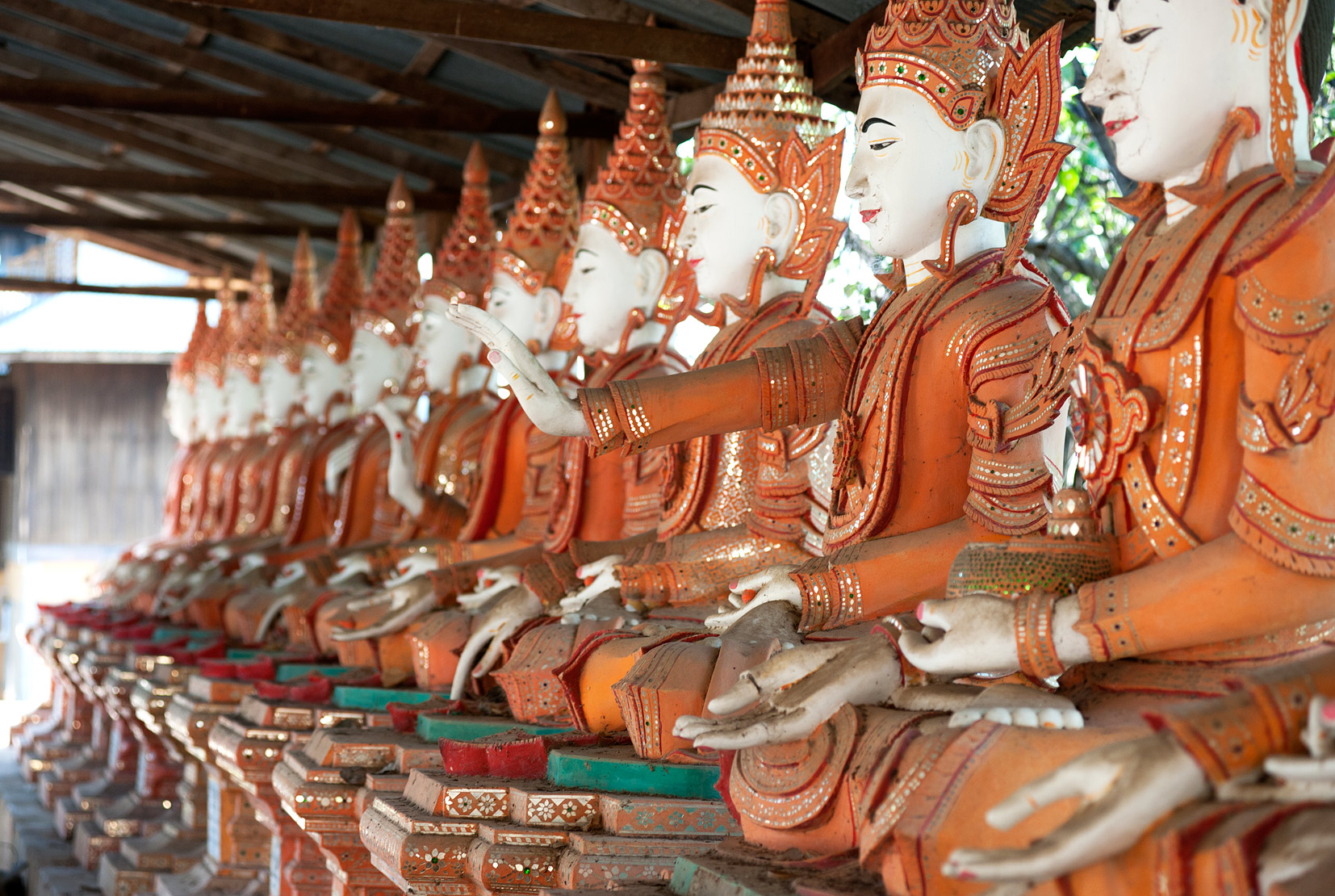 Line of seated Buddhas at the Maha Bodhi Ta Htaung monastery, Monywa township, Sagaing Division.