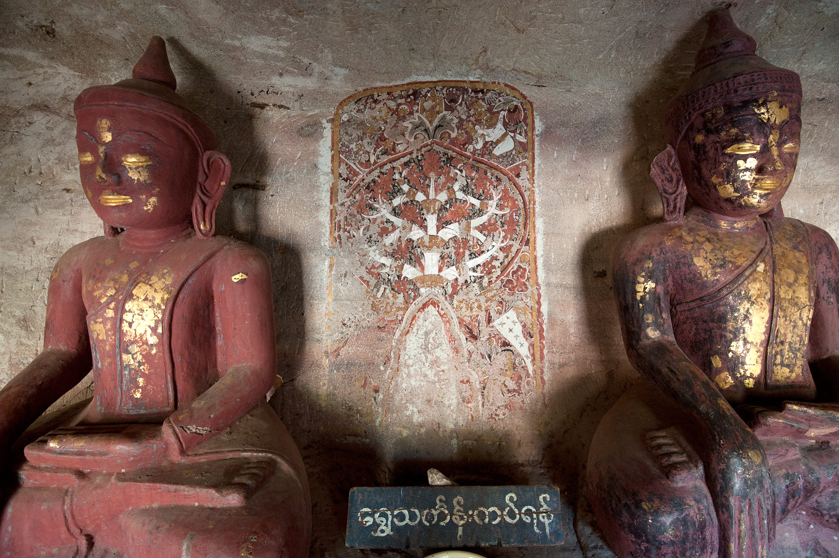 Buddha statues in one of the 947 Hpowindaung sandstone caves, 18th century paintings on the walls, Monywa, Sagaing District.