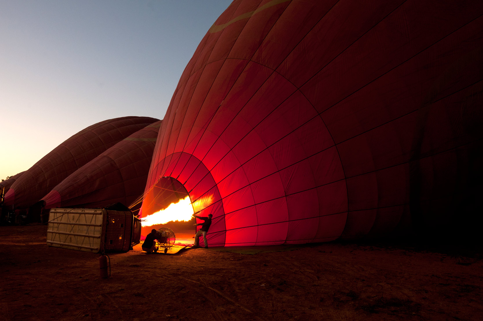 Blowing hot air into a hot air balloon in readiness for early morning flight over the temples of Bagan,  Mandalay Division.