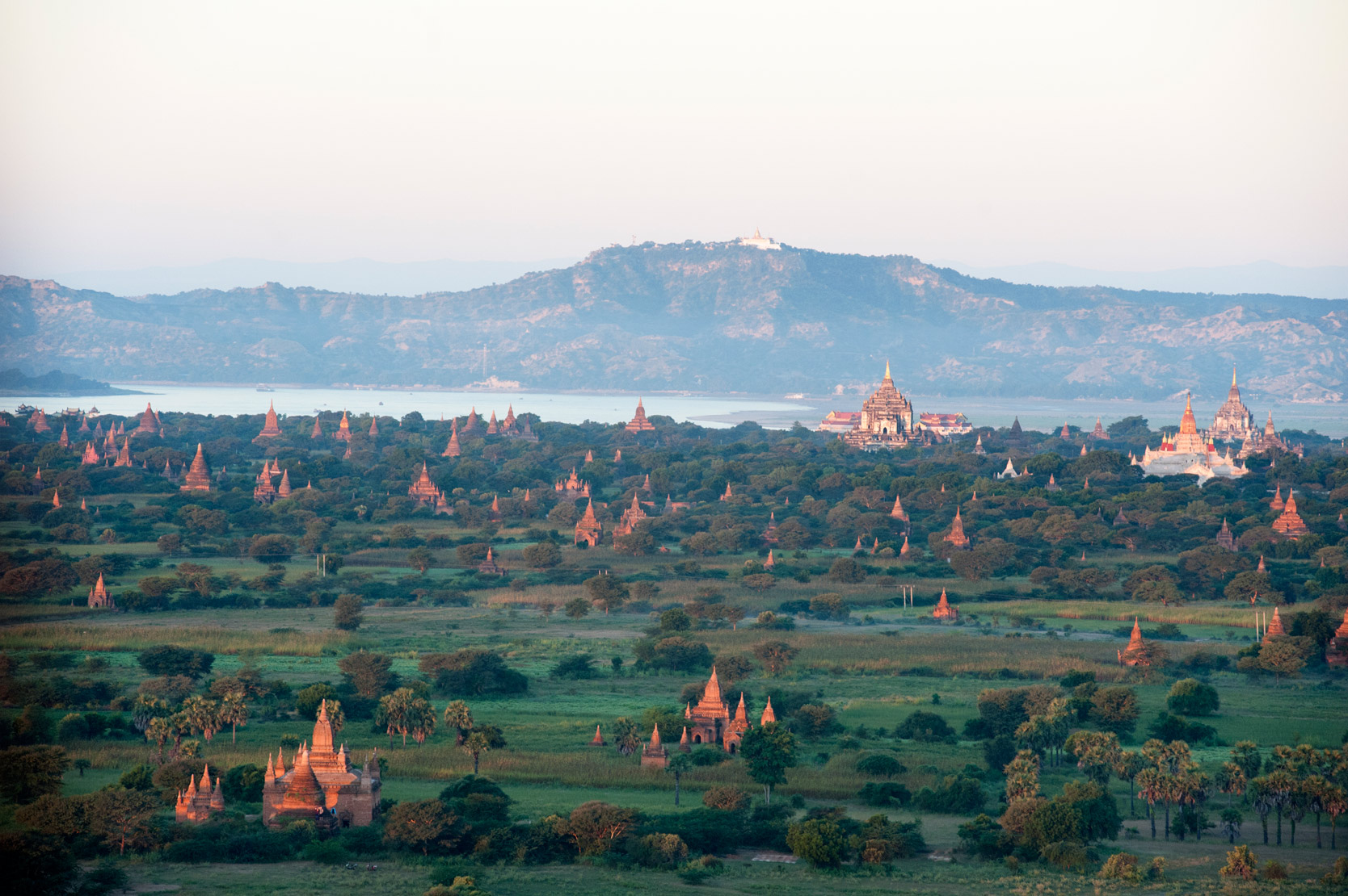 Early morning sunshine over the terracotta temples of Bagan, the Irrawaddy river in the distance, Bagan, Mandalay Division.