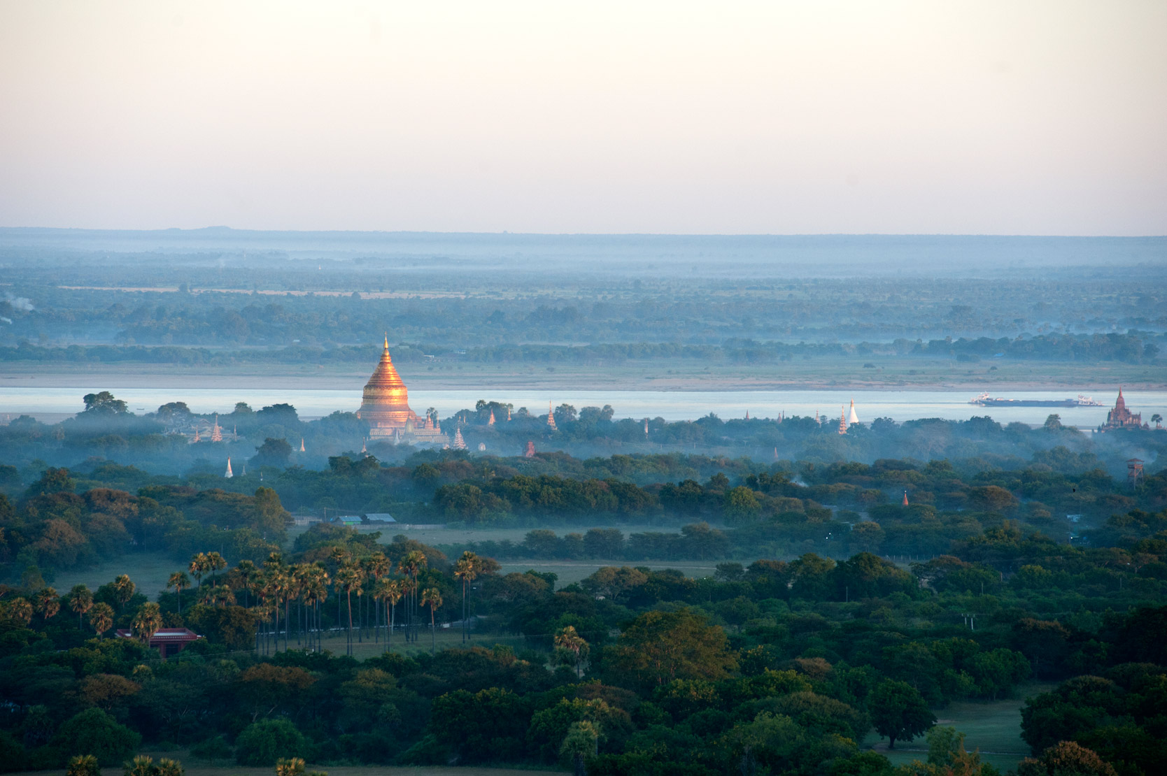Early morning sunlight on the Shwezigon Paya, amongst mists rising from the nearby Irrawaddy River, Bagan Mandalay Division.