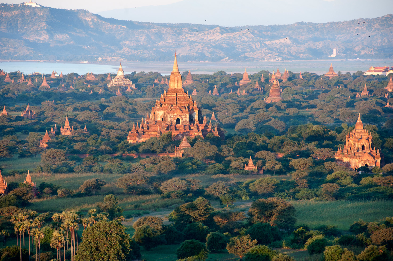 Htilominlo Buddhist temple and others, illuminated by the early morning sunrise over Bagan, founded in 9th century, Mandalay Division.
