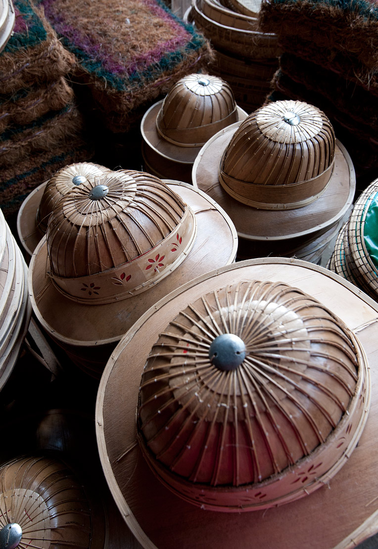 Burmese hats hand made from bamboo leaves and grasses, for sale in roadside market on Mandalay Road, Myanmar.